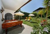 Garden with sunbathing area and pleasant seating at Pension Haller